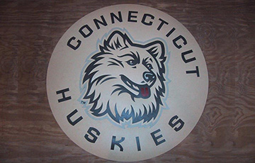connecticut huskies logo on linoleum tile